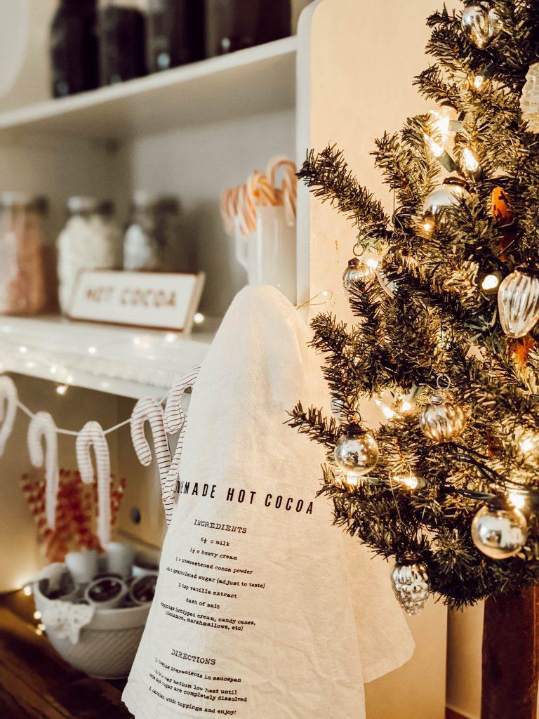 Christmas tree on the coffee bar next to hearth and hand tea towel