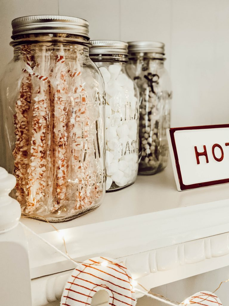 vintage atlas mason jars filled with cocoa bar supplies