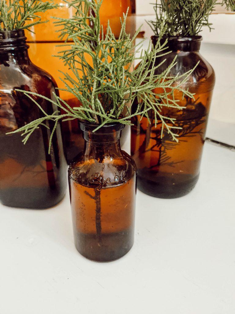 vintage brown lysol bottle with cedar trimmings