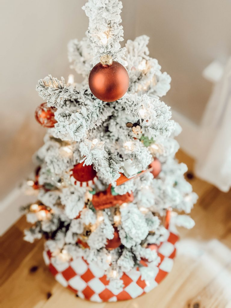 mini flocked Christmas tree with red ornaments