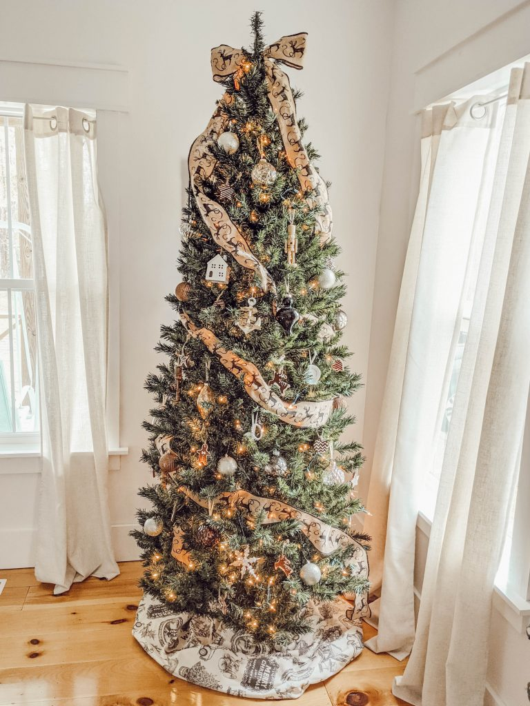 neutral themed Christmas tree with cream colored vintage print tree skirt