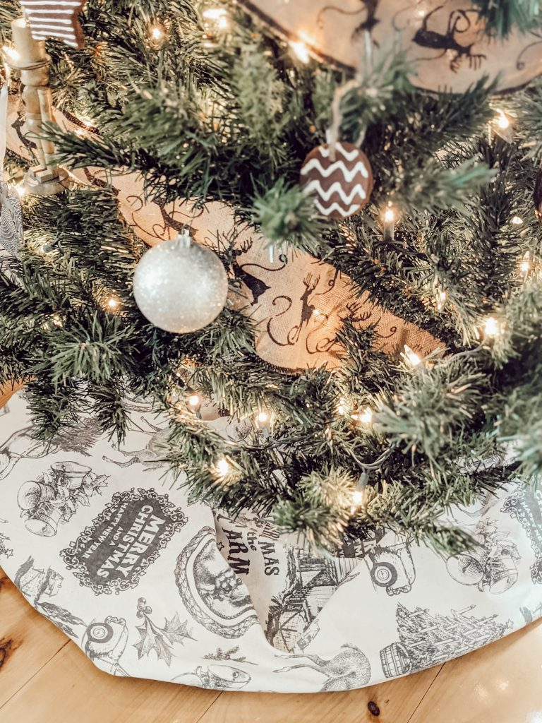 neutral themed tree with cream colored vintage print tree skirt