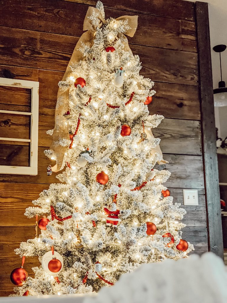flocked Christmas tree with classic red ornaments